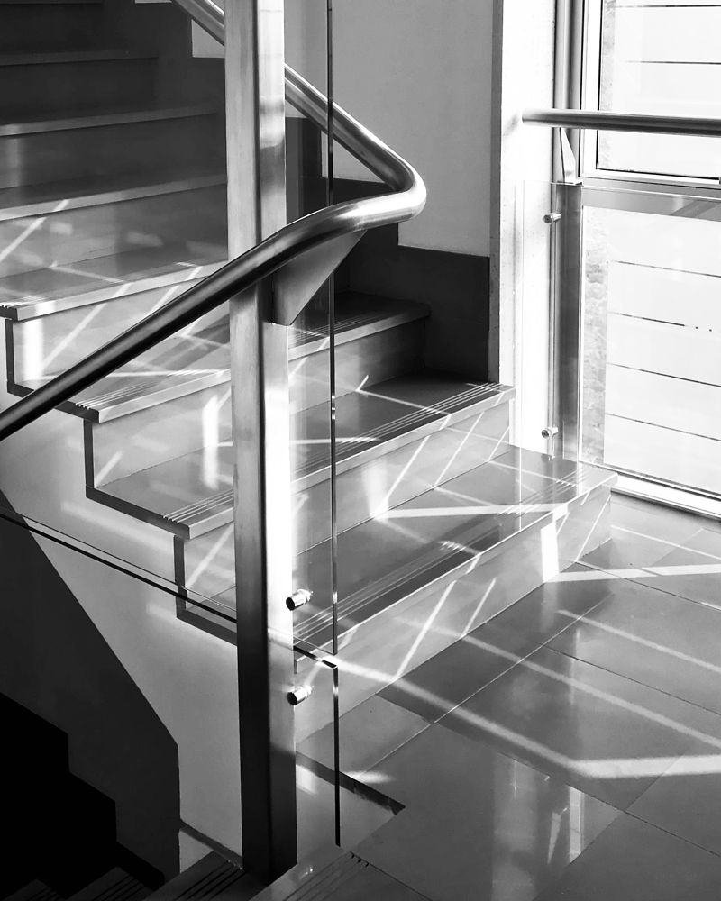 Photo in Random #reflection #lightandshadows #patterns #bw #bwphotography #blackandwhite #blackandwhitephotography #architecture #detail #staircase