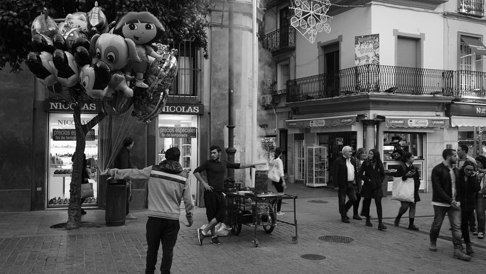 Photo in Street Photography #balloon #chestnuts #roasting chestnuts #plaza del salvador #seville #sevilla