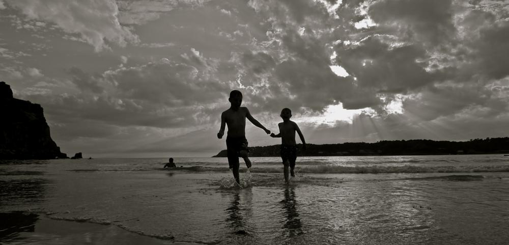Photo in Sea and Sand #beach #sunset #brothers #sea #water #silhouette #sun #jersey