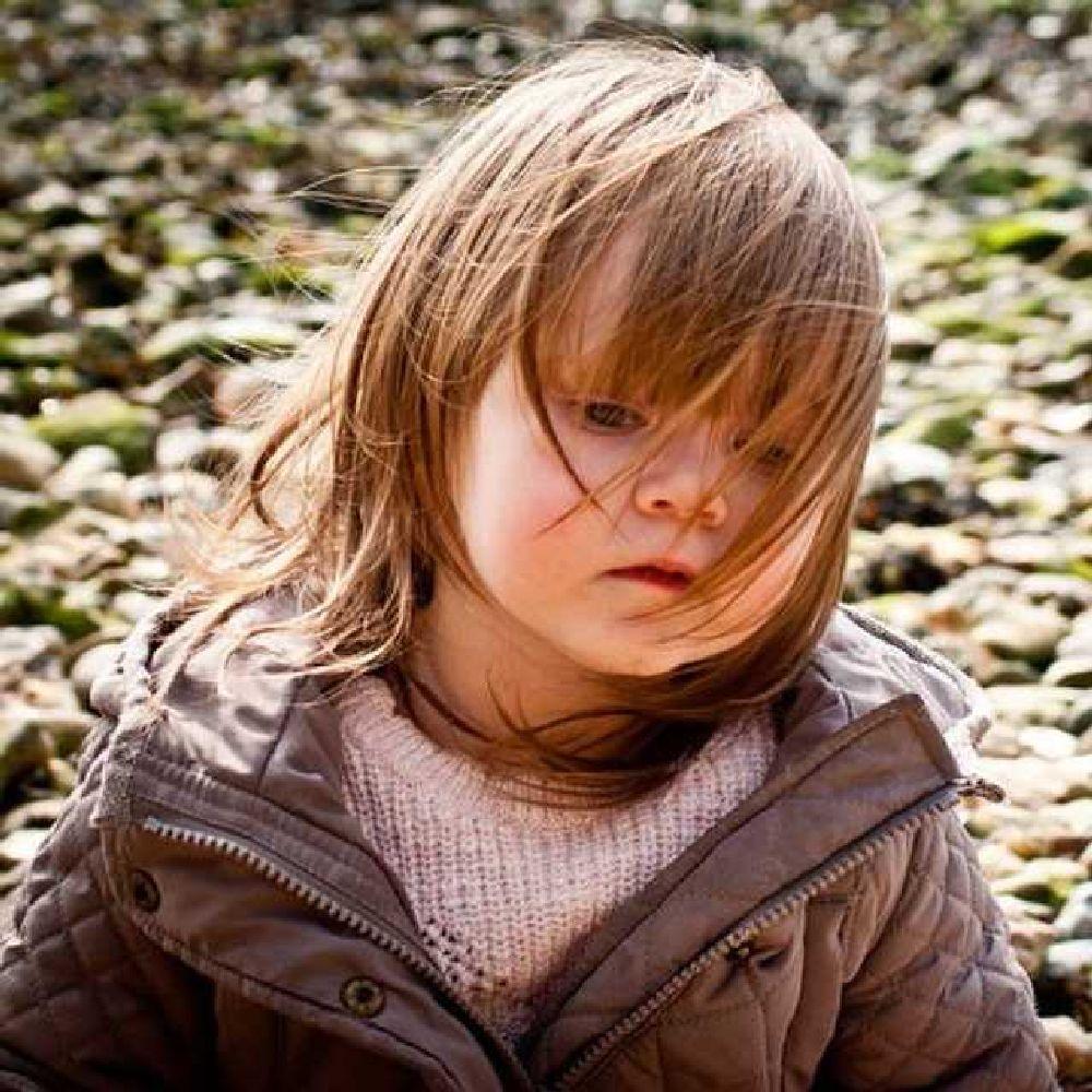 Photo in Portrait #portrait #photograph #wind #beach #hair #granddaughter #child #toddler #weather