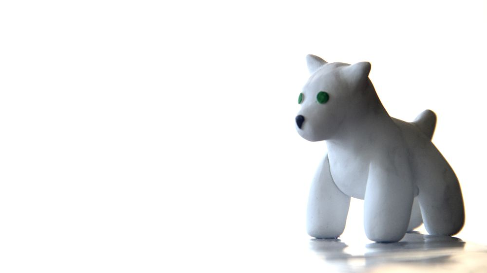 Photo in Still Life #dog #of #clay #little #animal #toy #sculpture #handmade #canine #white #light #green #eyes #pup #puppy #faux dog
