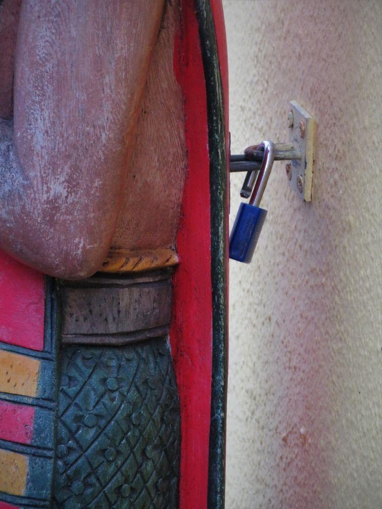 Photo in Street Photography #padlock #sculpture #wall #screws #wood