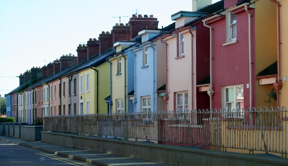 Photo in Architecture #red #blue #pink #yellow #purple #houses #fence #road #chimneys #windows #porches