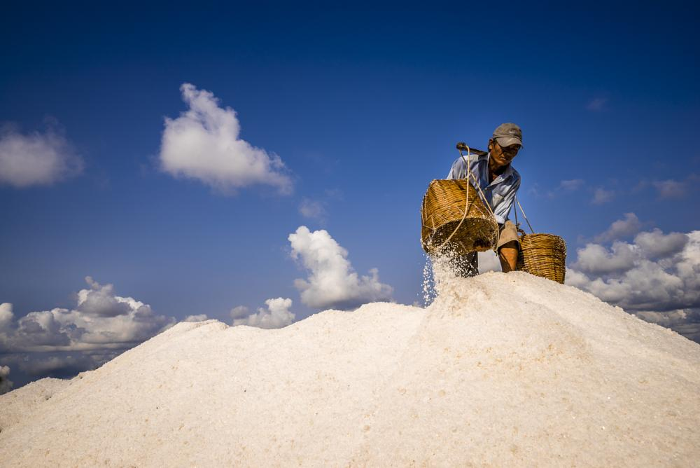 Photo in People #salt #people #labour #vietnam #vietnamese #asia #asian #poor #farmer #field #sky #cloud