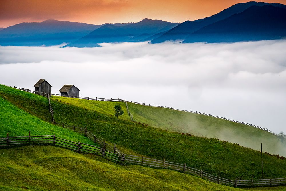 Photo in Landscape #morning #mist #fog #landscape #photography #rustic #grass #mountains #fence #wood #meadow #yard #shed #chalet #bucovina #light #daylight #garden #green #bucolic