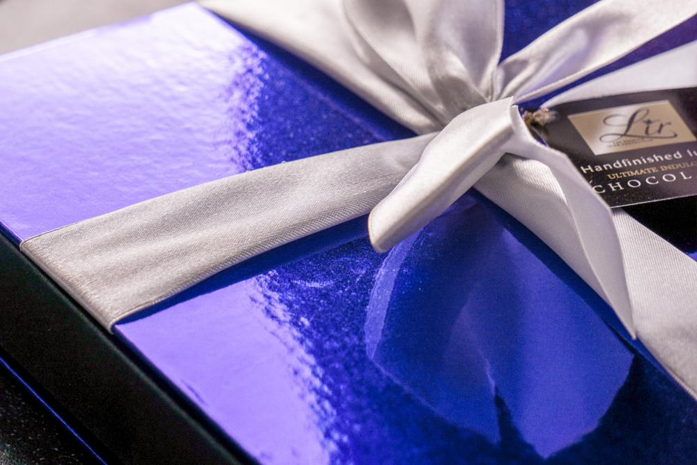 Photo in Still Life #gift #chocolate #bow #satin #purple #a6000 #shimmery #food