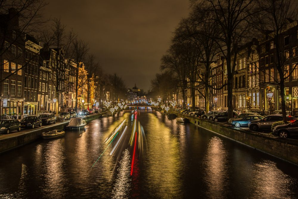 Photo in Cityscape #boat #boats #water #reflection #canal #light #lights #movement #long exposure #city #houses #buildings #architecture #cityscape