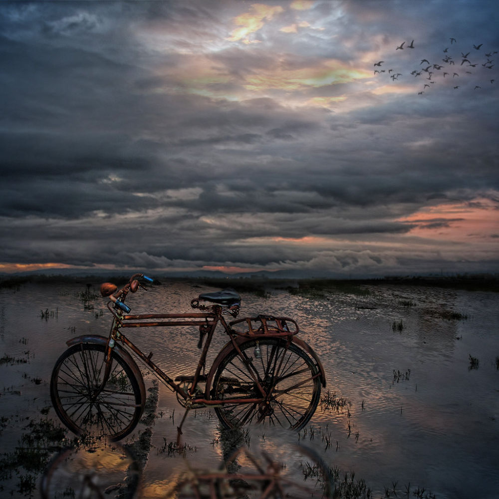 Photo in Fine Art #bibycle #lake #fine art #digital art #photoshop #manipulation #sky #clouds #blue #orange #hellas #greece #volos #glart