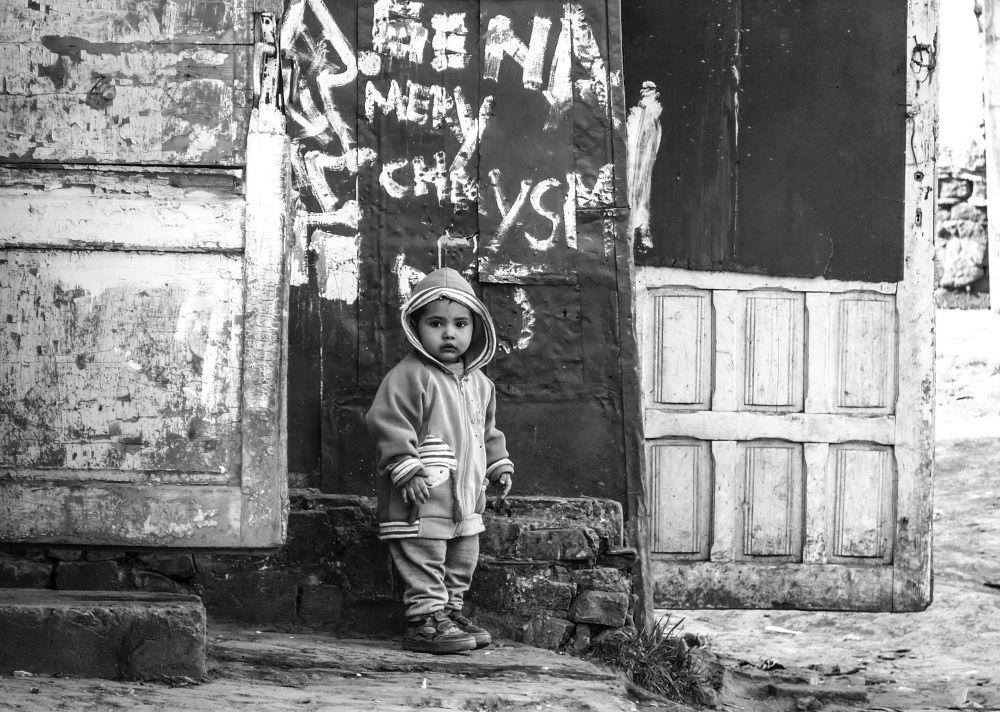 Photo in Journalism #boy #outside #door