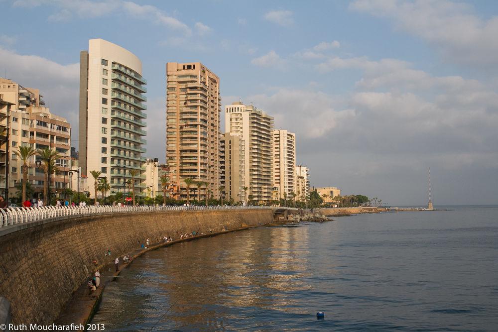 Photo in Landscape #beirut #lebanon #corniche #sea #buildings #city #water #reflections #cityscape #fishermen