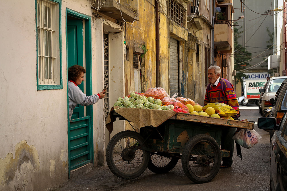 Photo in Street Photography #lebanon #street #beirut #vegetables #man #woman #barrow #tradition #delivery #door to door #selling #buying #colours #job\work #fruit