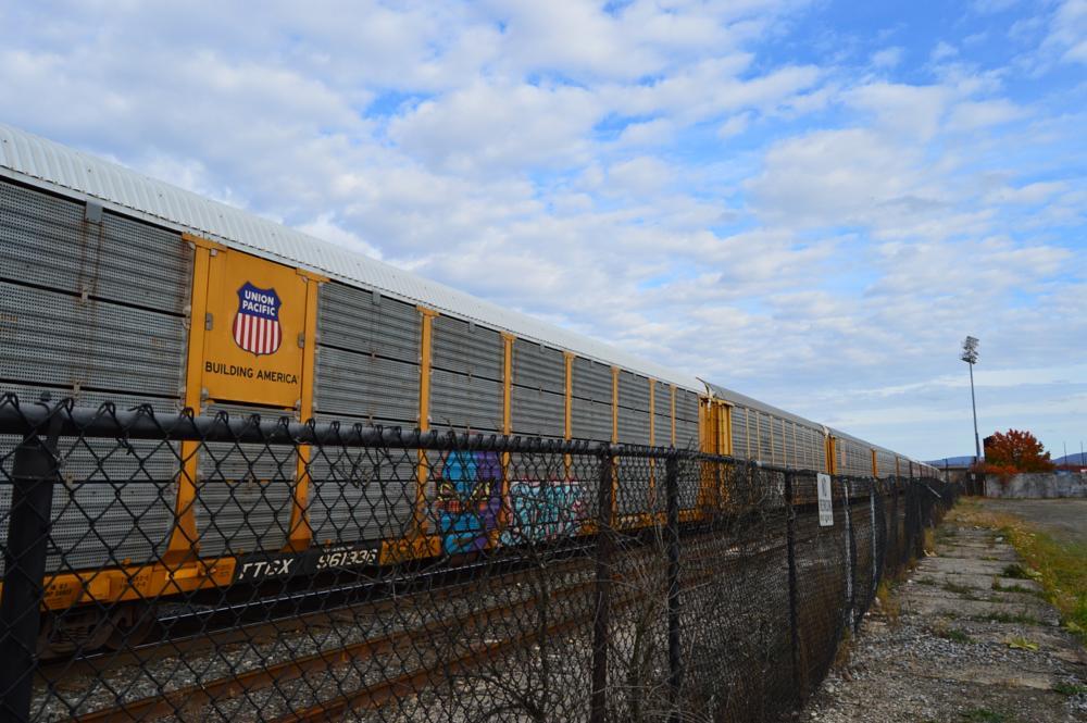 Photo in Travel #trains #sky #blue #grafitti