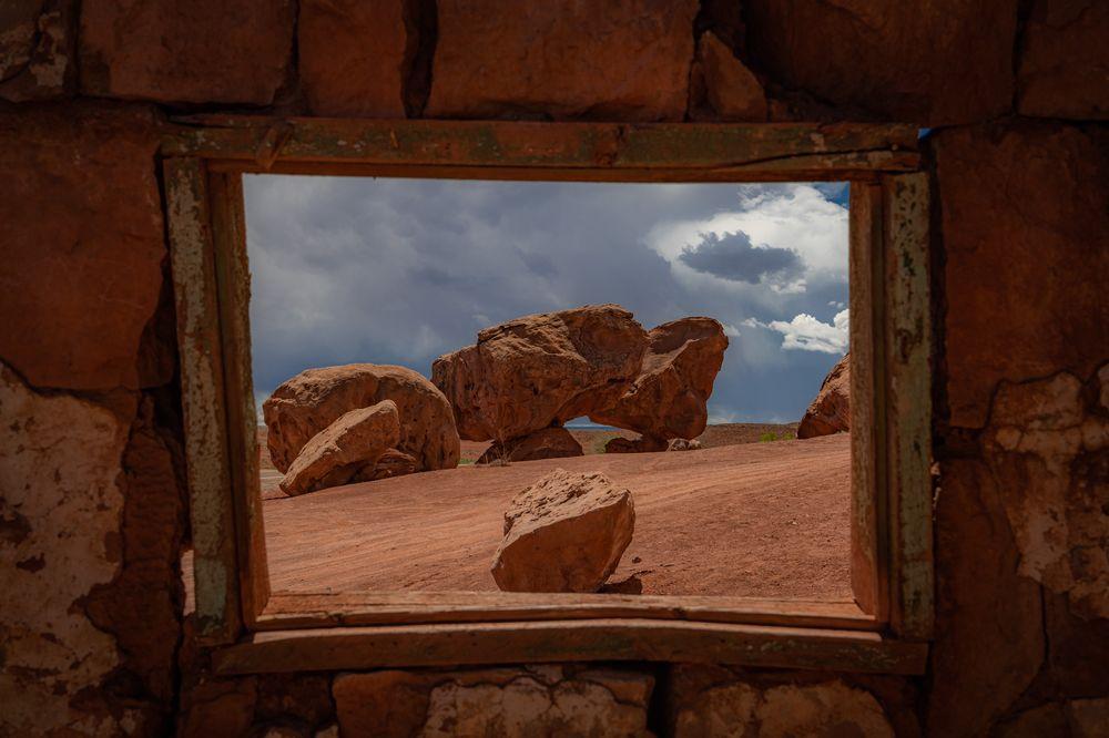 Photo in Landscape #rocks #desert #ruins #window #clouds