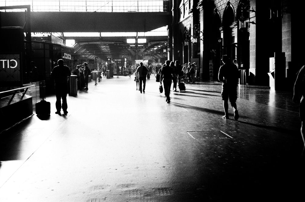 Photo in Street Photography #people #kiss and goodbye #sun #light #shade #train #railway station #zurich #switzerland #busy?