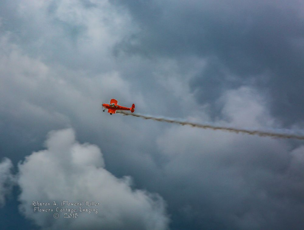Photo in Vehicle #plane #airplane #red #tiger #stripes #clouds #contrast #storm #stormy
