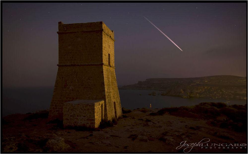 Photo in Random #falling stars #tower #bay #sea #malta #stars
