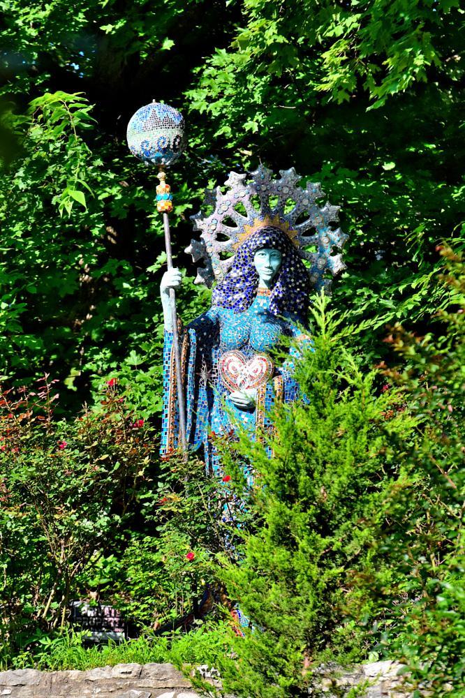 Photo in Street Photography #statute #garden statute #flowers #basin park #eureka springs #arkansas #arkansawhillbilly #google me: lawrence scott hess
