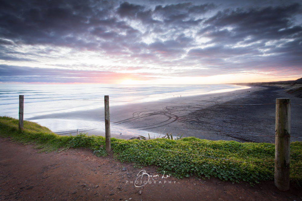 Photo in Landscape #ypa2013 #muriwai #beach #sand #fence #wire #grass #sunset #tracks #ocean #water #waves #sea #salt #night #cloud