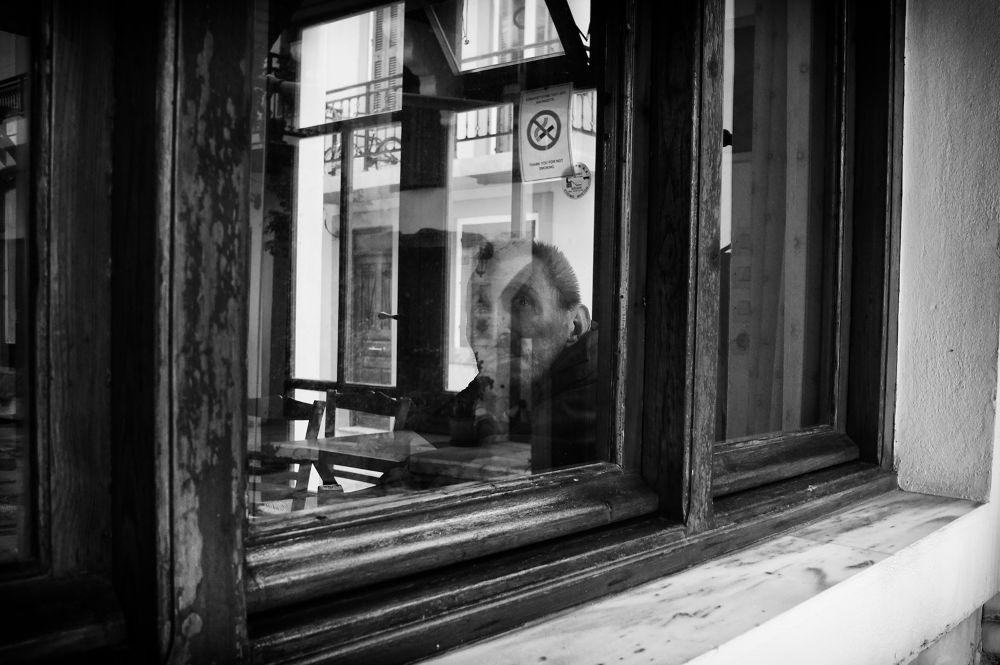 Photo in Street Photography #mono #monochrome #b&w #b&w photography #black and white #street hunters #street photography #street portrait #portraiture #candid photography #sel20f28 #candid portrait #20mm #rethymno #crete #man #looking #greece #stunned #window #staring #reflection #sony nex #nex-66 #nex-6
