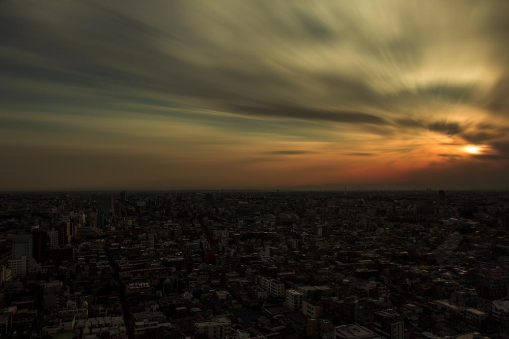 Photo in Cityscape #japan #tokyo #sunset #long exposure #clouds #city #cloud blur #couds #cityscape