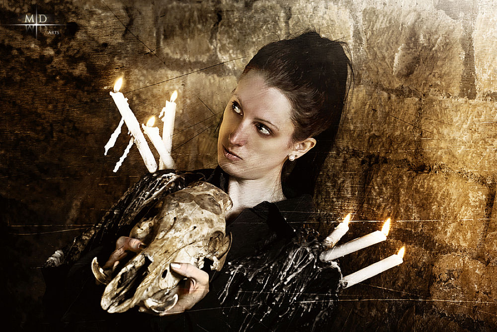 Photo in Random #girl #woman #dark #vampire #gothic #black #shirt #candle #was #skull #head #boar #bones #fire #cave #crypt #brick #wall #eerie #macabre #sorceress #invocation #sorcery #ritual #dead #old #ancient #look