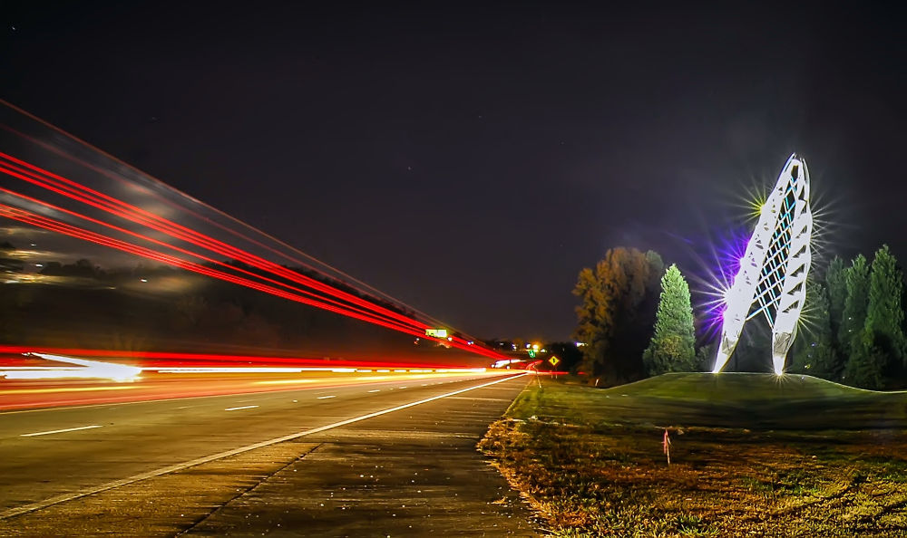 Photo in Abstract #long exposure #night #airport entrance sculpture #lights #trails #charlotte