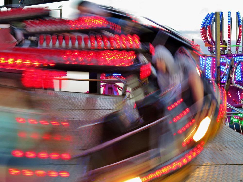Photo in People #hoody #fair #ride #people #colour #lights