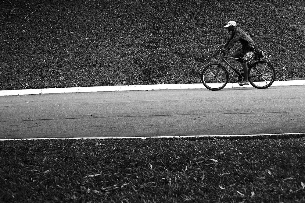 Photo in Street Photography #man on a bike #black & white #street photography