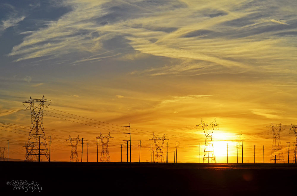 Photo in Landscape #sunset #power lines #orange sky #desert #landscape #lancaster ca