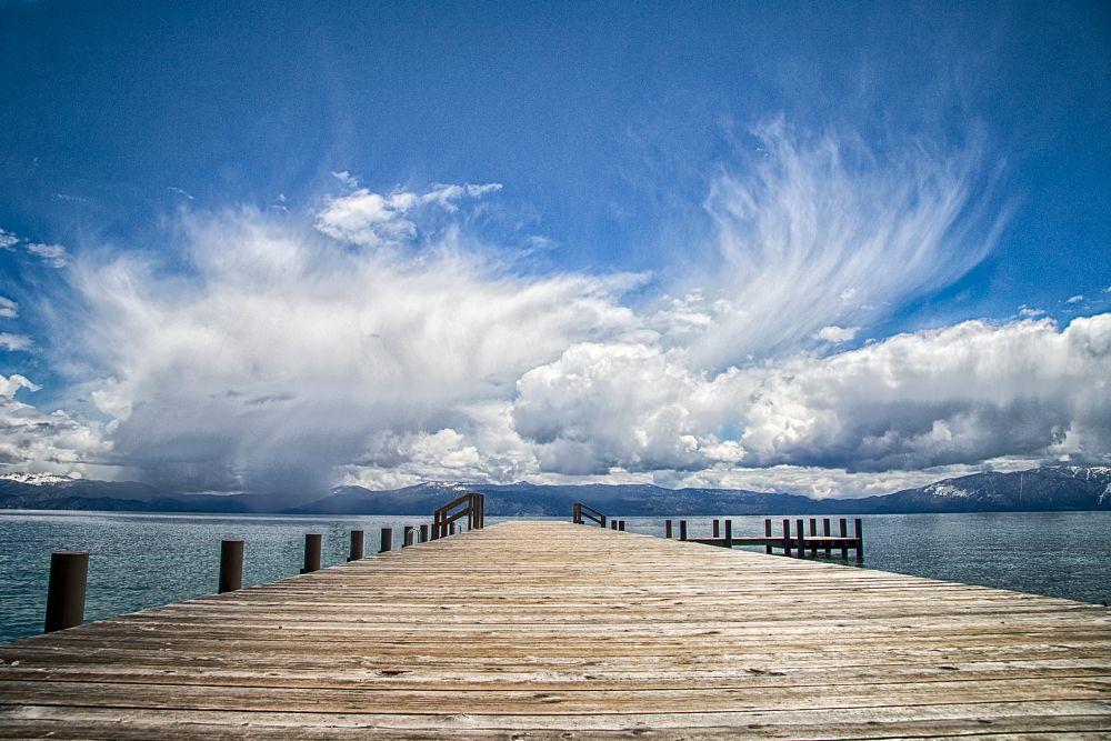Photo in Landscape #laketahoe #pier #rainclouds #raining