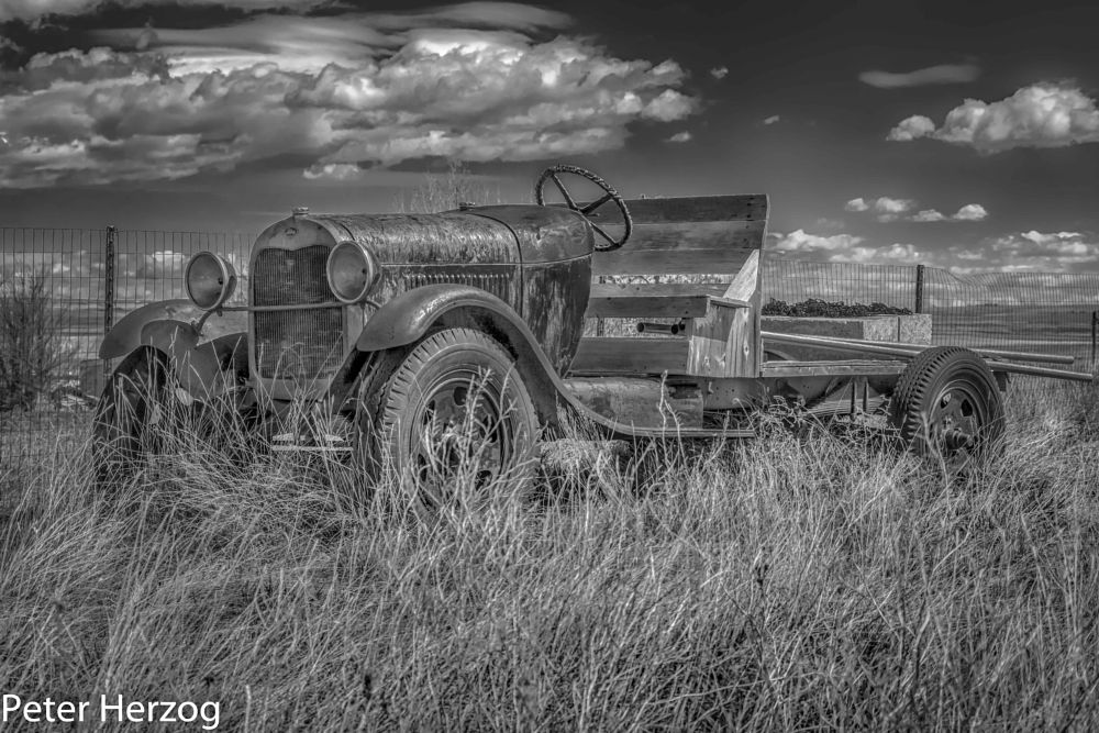 Photo in Black and White #vintage #car #truck #sky clouds #grass #pipes #wheels #fence #peter herzog photography