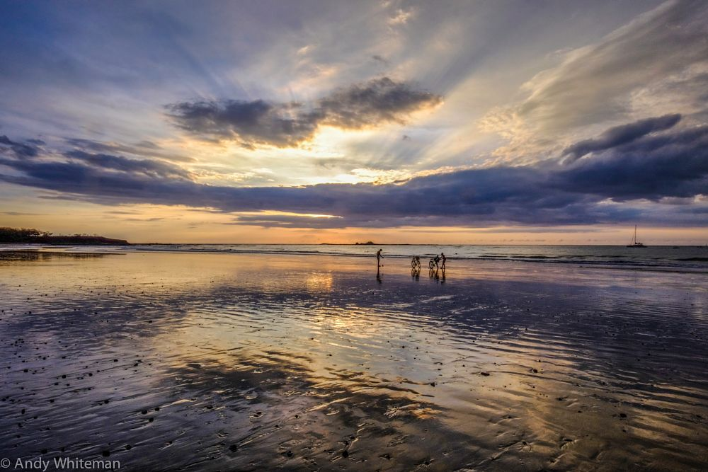 Photo in Landscape #sunset #playa tamarindo #bikes & riders #reflections #yacht #ocean #colours #clouds
