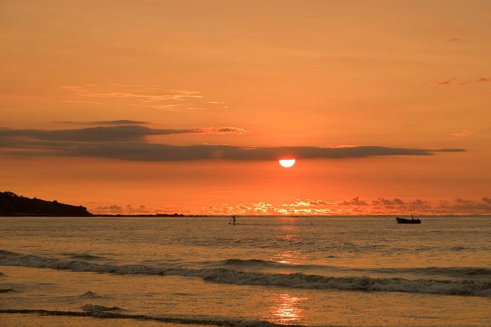 Photo in Landscape #sunset #paddle board man #clouds #colours #ocean #boat #sun #playa tamarindo