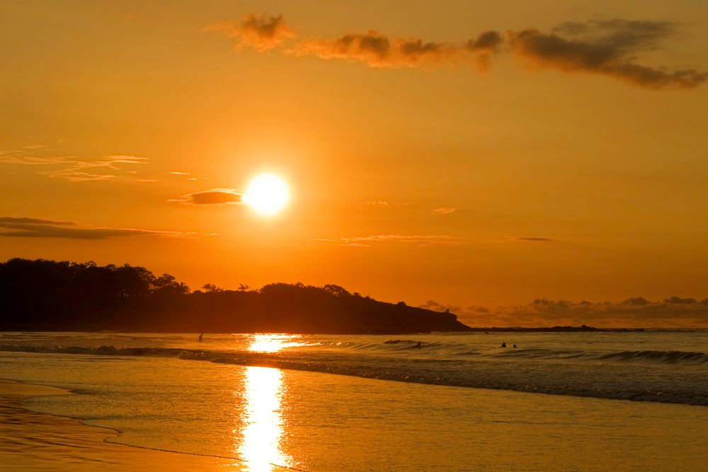 Photo in Landscape #sun #sky #clouds #ocean #surfers #sunset