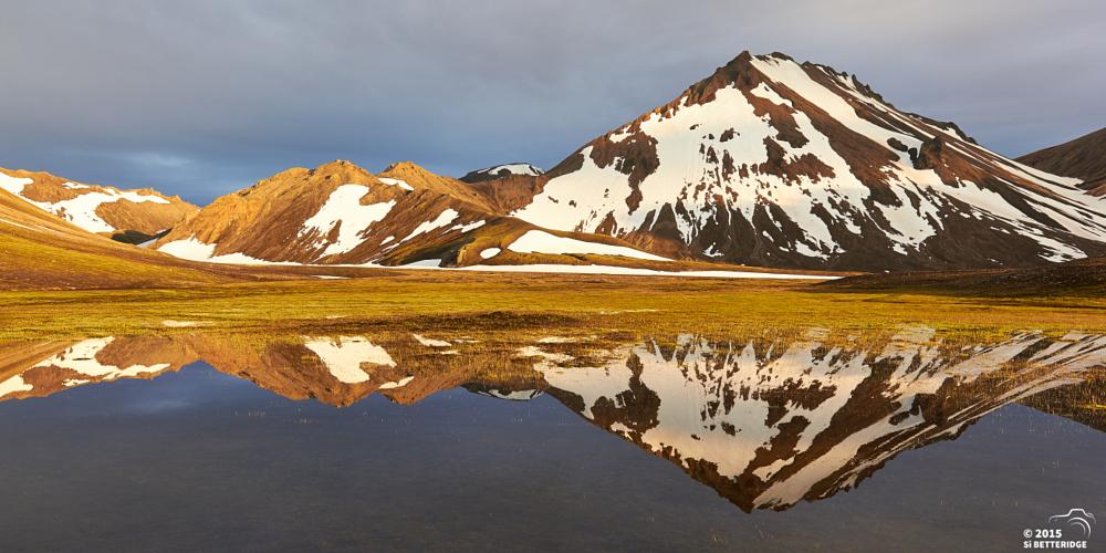 Photo in Landscape #mountains #reflection #snow #colourful #glow #goldern #iceland #light #water #mirror #sunset