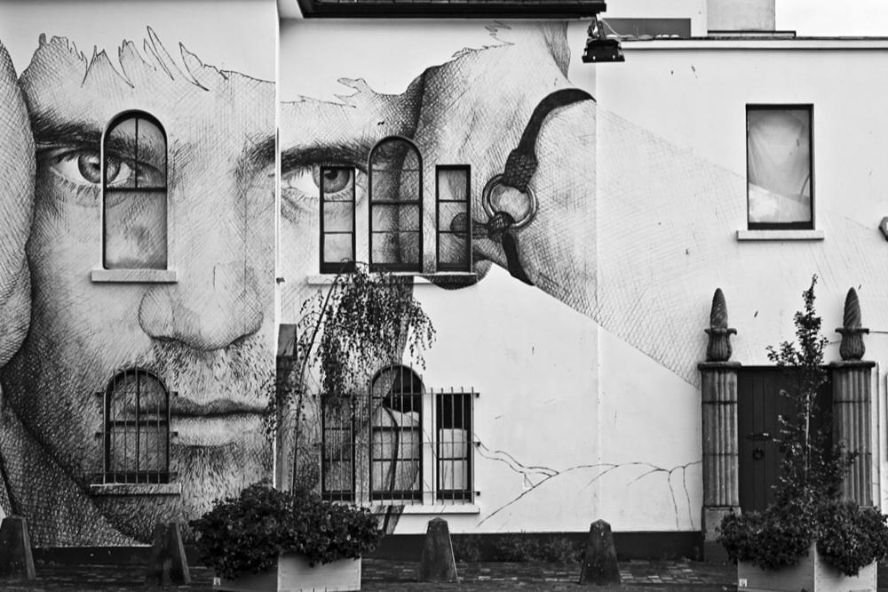 Photo in Street Photography #street #building #mural #street art #art #face #man #head #pencil #architecture #modern #decoration #house #perspective #view #urban #eyes #galway #ireland #large #big #picture #image #streetcontest