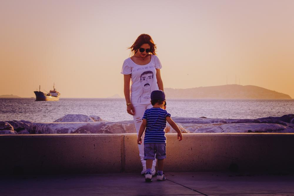 Photo in People #mother #son #child #woman #street #coast #sea #ship #sunset