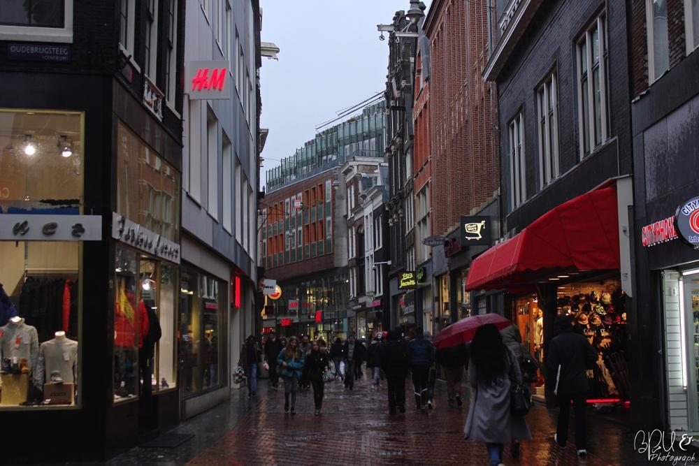Photo in Street Photography #amsterdam #netherlands #netherland #nederland #dutch #rain #day #dag #raining #umbrella #commerce #center #stores #store #winter #vinter