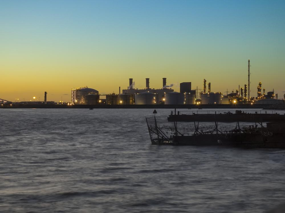 Photo in Industrial #water #smooth #lights #sunset #blue hour #industry