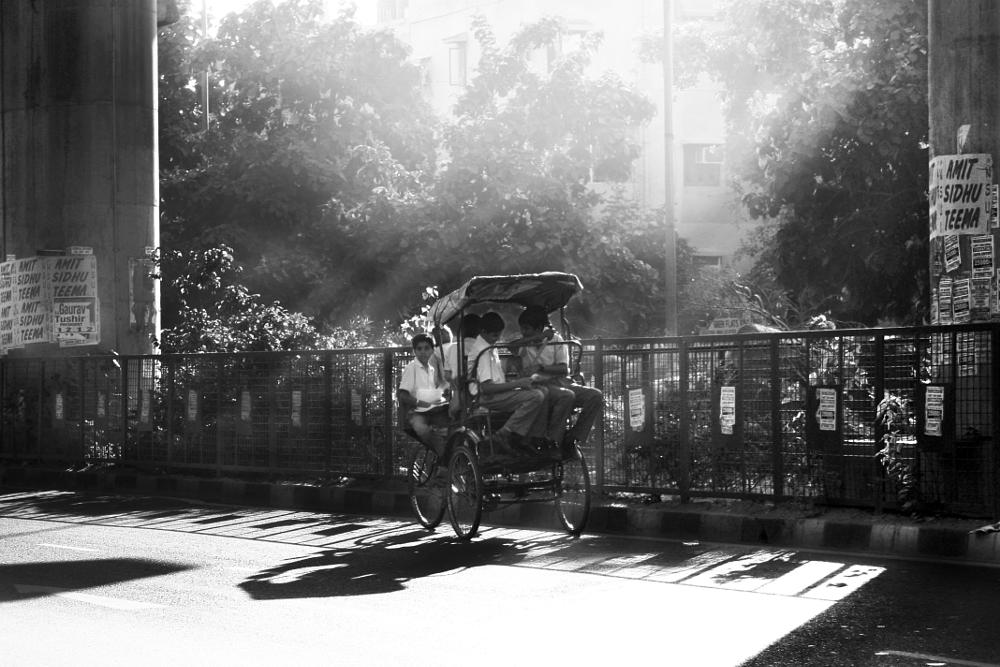 Photo in Street Photography #school children #early morning #morning rays #cycle rickshaw #black and white