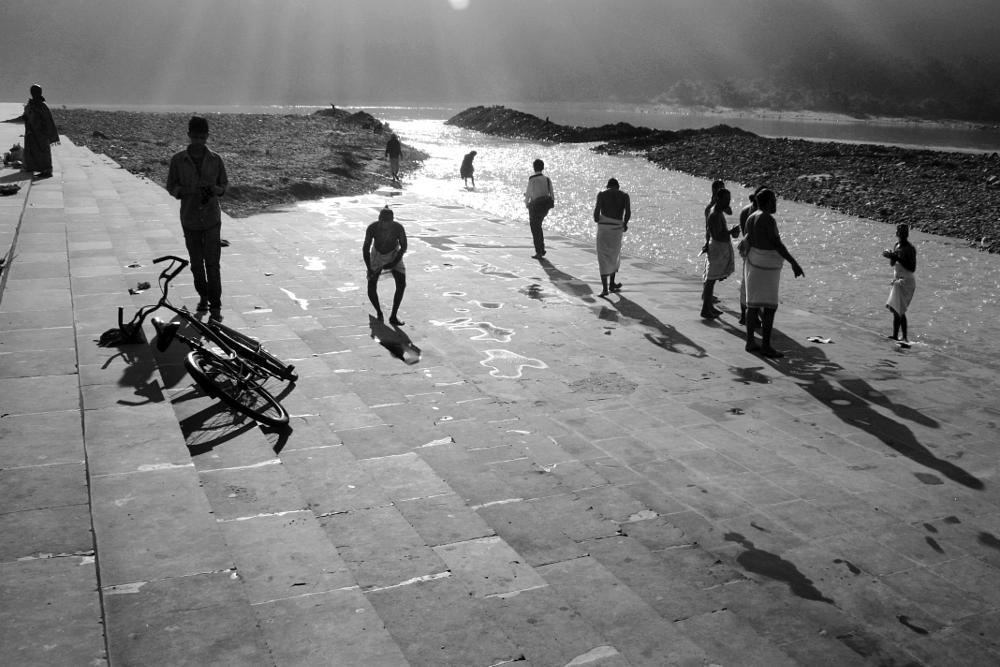 Photo in Street Photography #gnaga river #rishikesh #people #early morning #black and white #rays