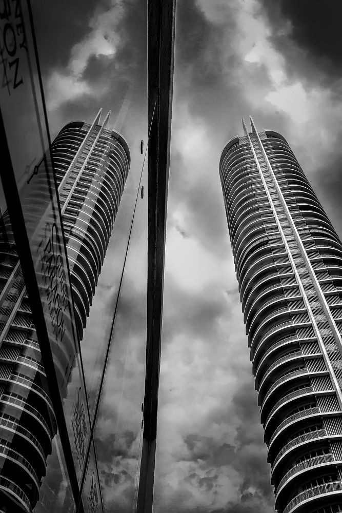 Photo in Architecture #abstract #black and white #buildings #cloudy #fine art #penang #malaysia #nikon #d5100 #perspective #reflection #twin tower #architecture #city #skyscapper