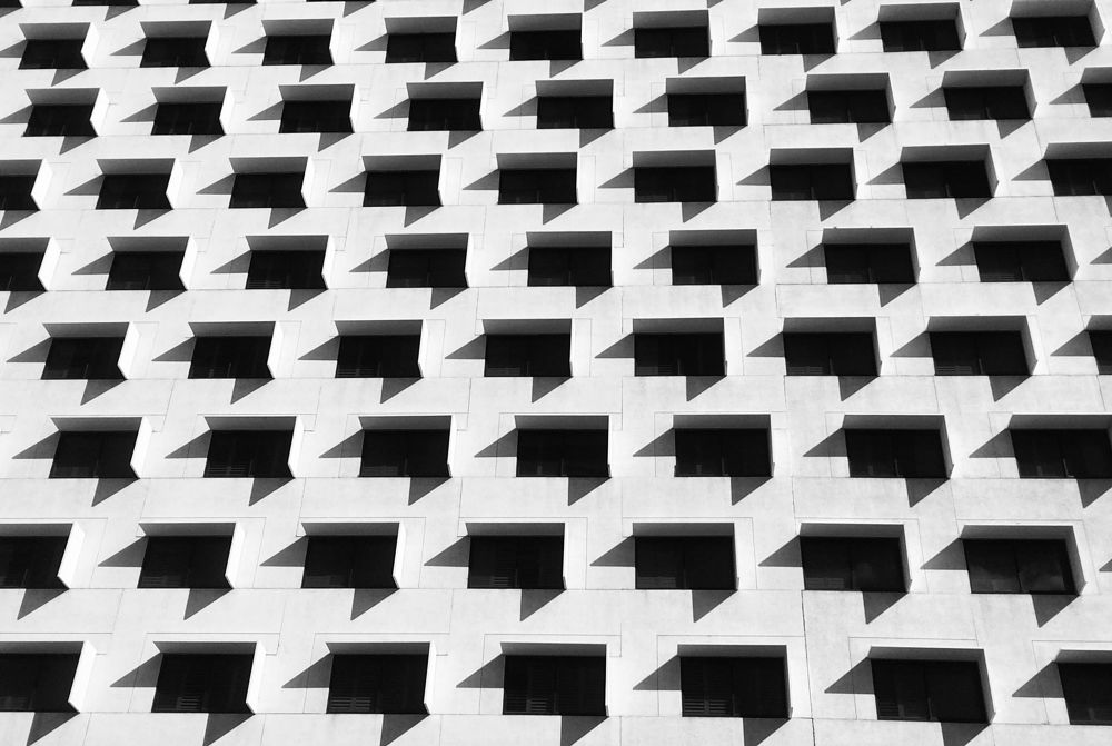 Photo in Abstract #abstract #architecture #patterns #b&w #las vegas #windows #building #shadows #light #contrast