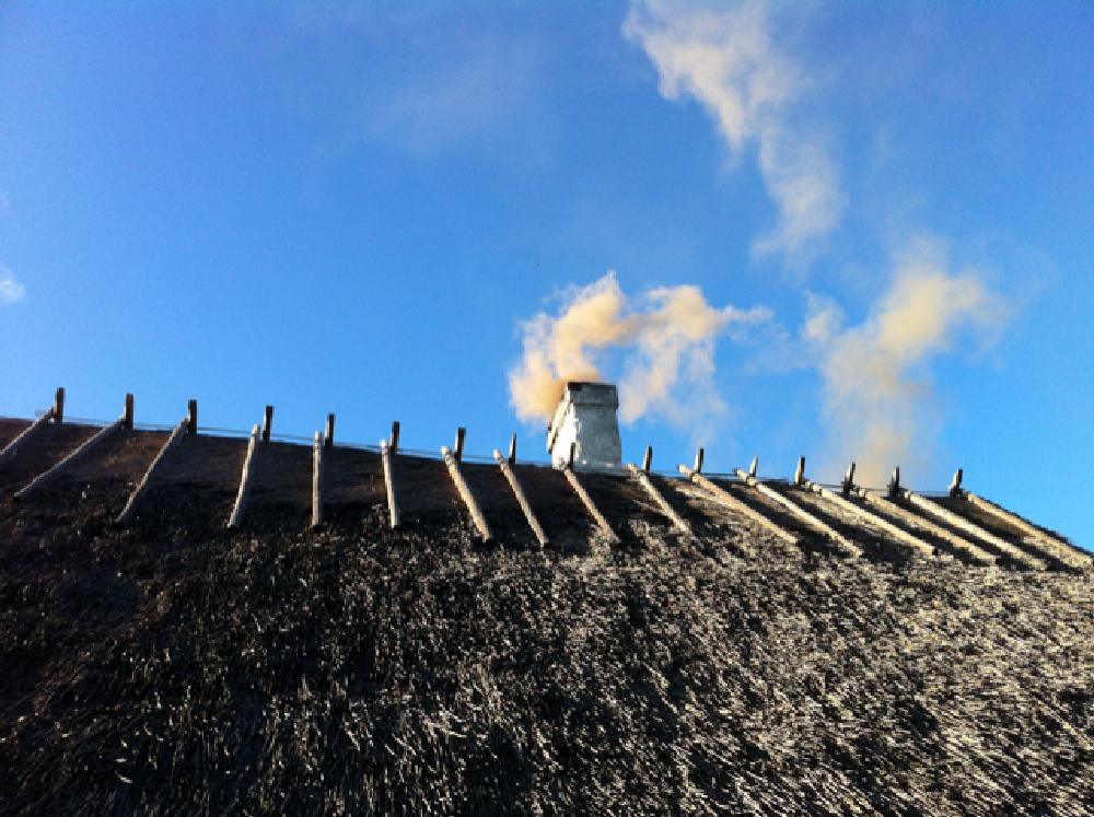 Photo in Architecture #chimney #smoke #straw #roof #sky