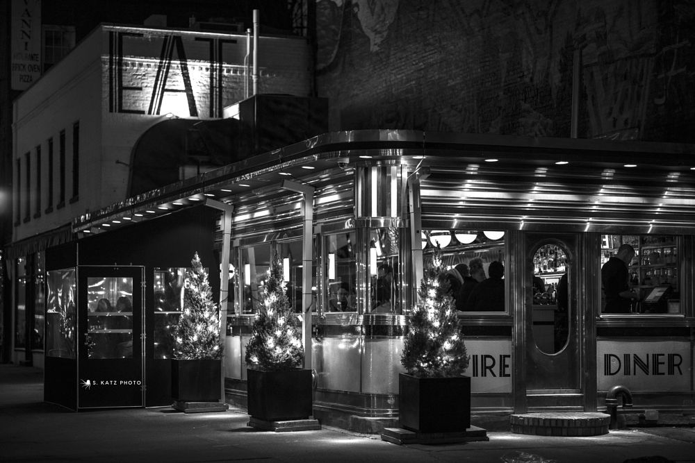 Photo in Street Photography #eat #diner #food #black and white #night #street photography