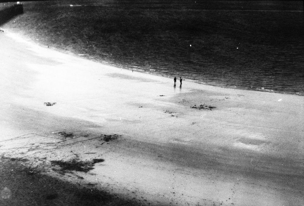 Photo in Black and White #paola camiciottoli photographe #black and white #person #sea