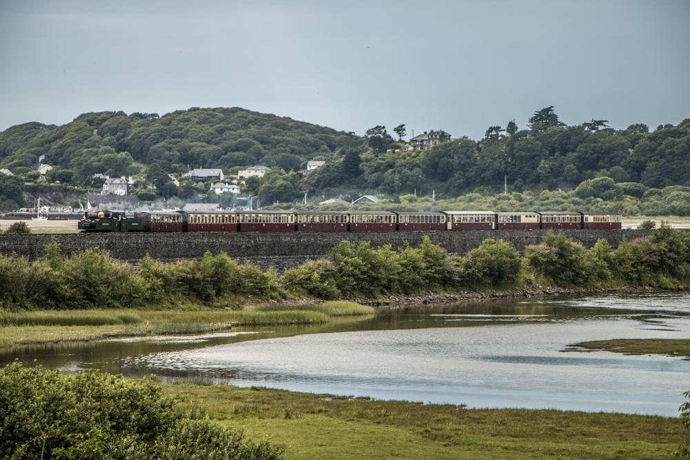 Photo in Landscape #narrow guage #engine #steam #carriages #cob #trees #buildings #water #grass #sky #ffestiniog #wales