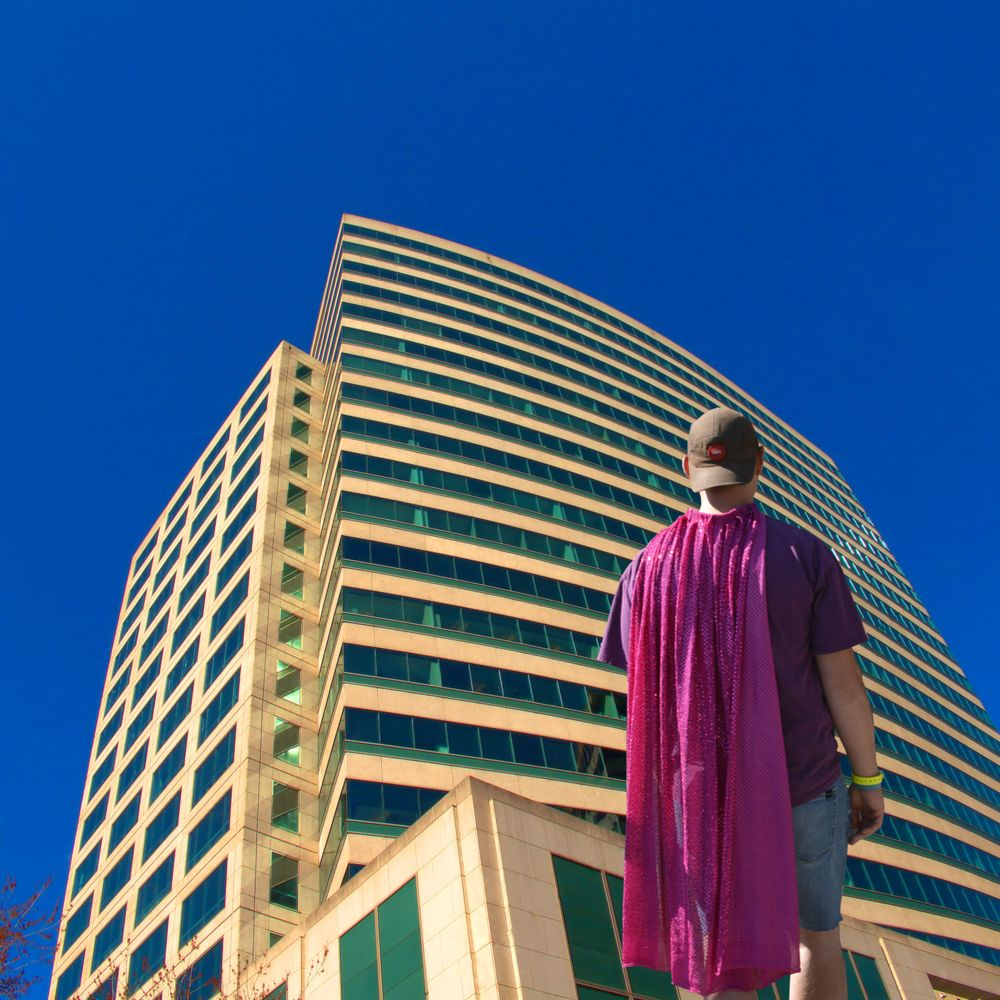 Photo in People #building #sky #fly #man #dream #cape #high #soar