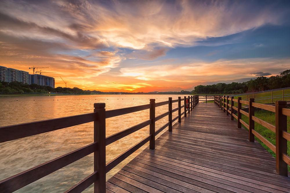 Photo in Landscape #landscape #sunset #clouds #park #singapore #linkway #water #building