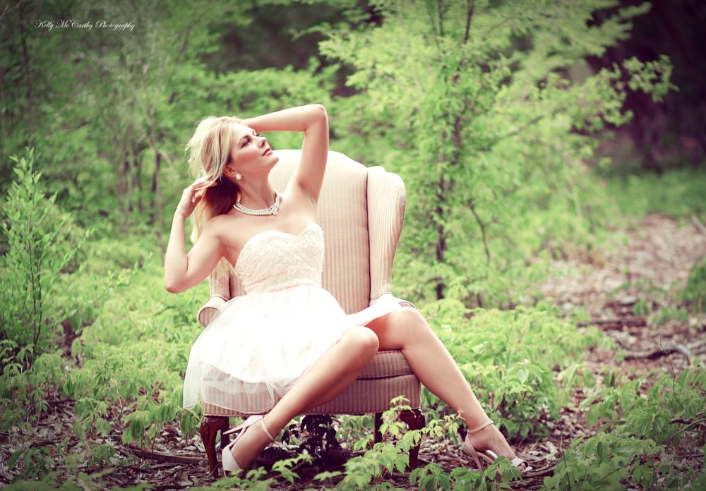 Photo in Fashion #woman #model #beautiful #beauty #pose #fashion #style #blonde #dress #heels #necklace #high heels #chair #outdoors #forest #fairytale #pink #green #bokeh